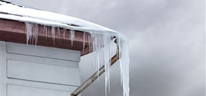 The Dangers of Ice Dams in Your Gutters